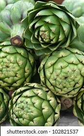 Stacked artichokes for sale at a farmers' market