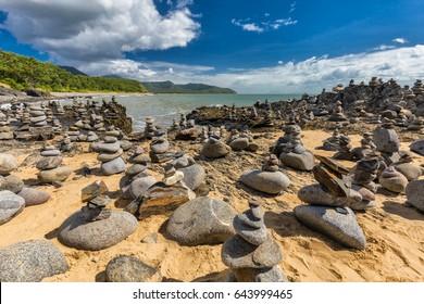 Stacked balancing rocks on the beach between Cairns and Port Douglas, Queensland, Australia
