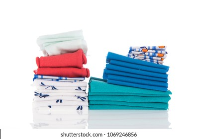 stacked bedding and linen isolated over white background