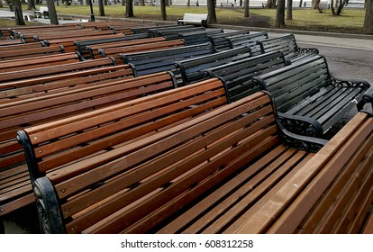 Stacked benches in city park prepared for season opening