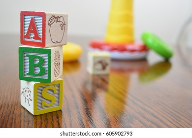 Stacked blocks with toys in background