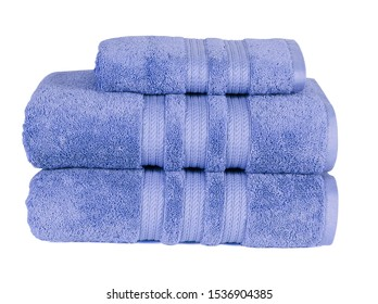 STACKED BLUE COTTON TOWEL SET ISOLATED OVER WHITE BACKGROUND.