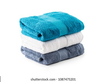 Stacked blue white and gray towels isolated on white.