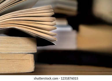 stacked books and blur background on wooden table