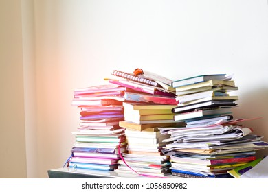 stacked the books cluttered white background