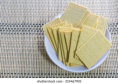 Stacked Butter Biscuits Cracker (close-up shot) on wooden background