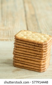 Stacked Butter Biscuits on wooden background