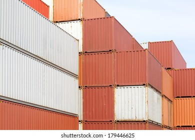 Stacked cargo containers in freight sea port terminal