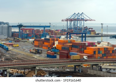 Stacked cargo containers in storage area of freight sea port.