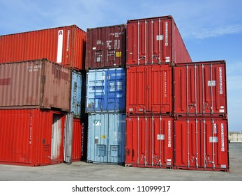 Stacked Cargo Containers waiting to be loaded