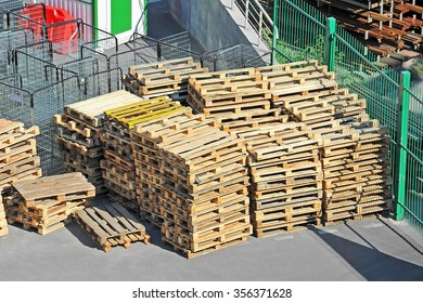 Stacked CEN (EURO) wooden pallets in warehouse