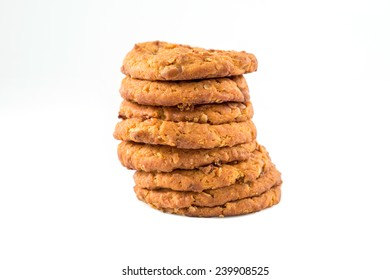 Stacked chocolate chip cookies  isolated on white background.
