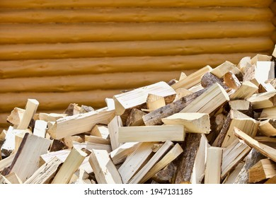 Stacked chopped firewood close-up. Firewood storage close up. Stocks of wooden logs close-up. Chopping wood. Logging in the village. Rustic lifestyle. Woodpile with firewood. Wood texture.