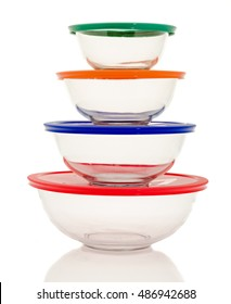 Stacked clear glass bowls on an isolated background