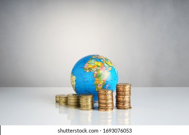 Stacked of coin and globe. Global economy concept