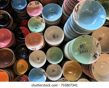 Stacked of colorful ceramic porcelain kitchenware selling in the market