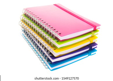 Stacked colorful notebooks isolated over white background