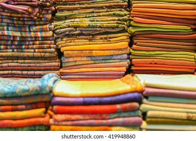 Stacked colorful Turbans for headwear, shallow depth of field