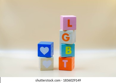 Stacked colourful wooden alphabet with word LGBT, Multicolour wood  heart cubes on antique white colour background with free copyscape, Social movements for gay, Lesbian, Bisexual and transgender.