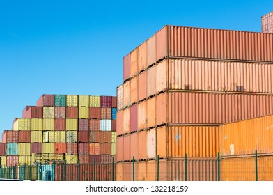 Stacked containers in the container terminals of Antwerp world port in Belgium - all brands and logos have been removed