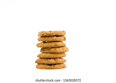Stacked cookie tower on white background. Copy space. Poster concept.