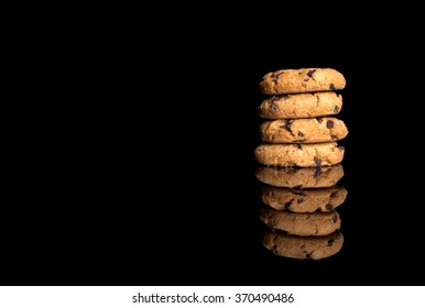 Stacked cookies isolated on black