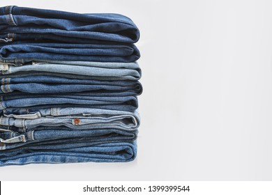 stacked of different Jeans background.