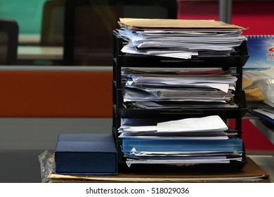 A stacked of file paper business report on a rack at office desk