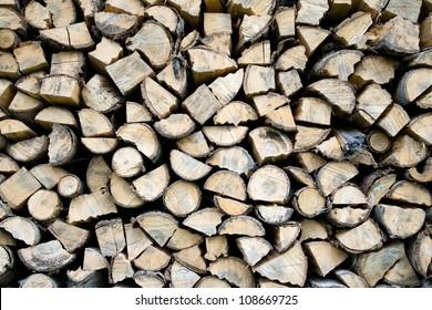 Stacked firewood background. Wood background