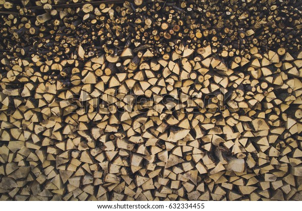 Stacked firewood makes a great texture. The countryside living always reminds such wooden textures and provide warmth during cold weather.