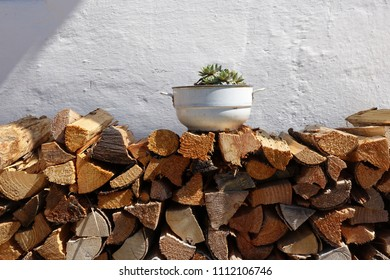 stacked firewood on white wall