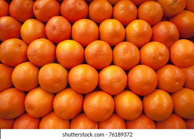 Stacked fresh oranges as a background image