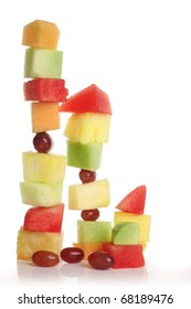 Stacked fruit slices. Watermelon, grape, cantaloupe, honeydew and pineapple.
