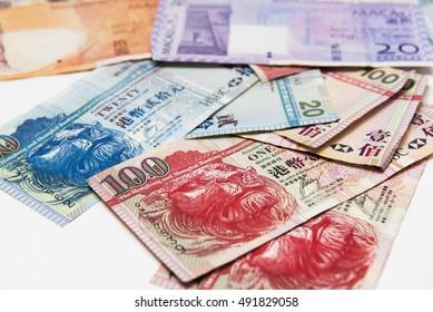 Stacked of Hong Kong and Macau Dollar bills,close up