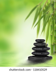 Stacked hot stones or massage stones and bamboo