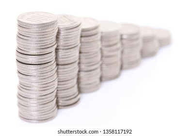 stacked Japanese 100 yen coins step down graph