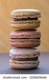 Stacked Macroons on a gold background.