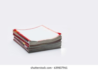 stacked magazines newspaper
