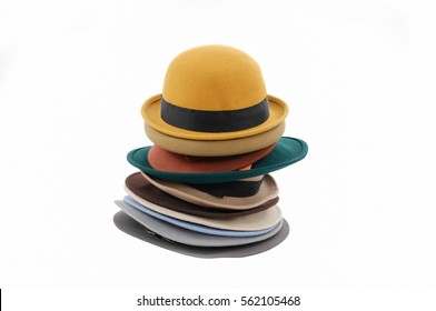 Stacked of many woman hat â??white background