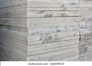 Stacked marble slabs and tiles