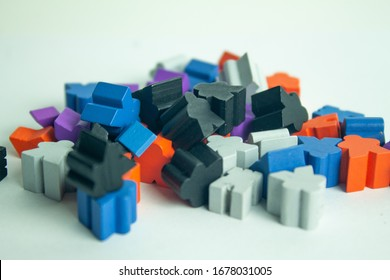 Stacked meeples prepared for a game of board game. Army of meeples colored wooden figures with human shape. To play.