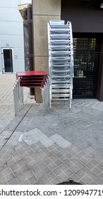 stacked metal chairs and tables