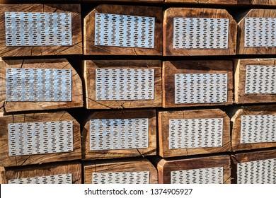 stacked of new wooden railway sleepers