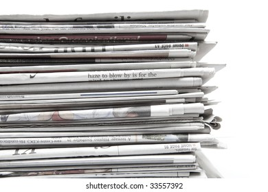 Stacked newspapers with white background