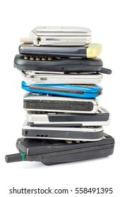 stacked of old and obsolete mobile phone and on white
