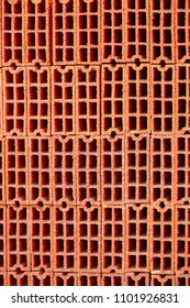 Stacked orange bricks. Construction industry. Industrial objects. Architecture. Vertical