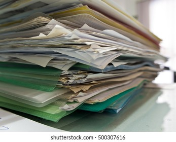 Stacked of paper documents in the office