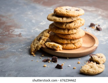 Stacked peanut butter cookies with chocolate chunks  on wooden plate