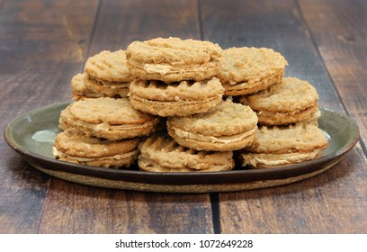 Stacked peanut butter and oatmeal cookies, with peanut butter filling.  Macro, front view image with copy space.