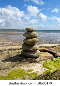 stacked pebble on a rocky beach
